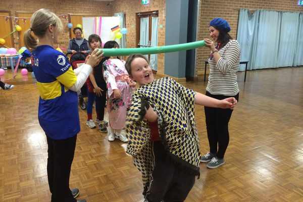 Children playing limbo. Link displays a larger version of the image.
